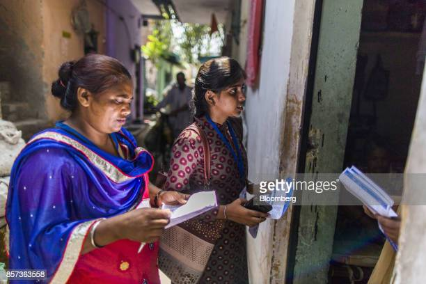 Amarjeet Kaur a payment collector for Tata Power Delhi Distribution Ltd known as an Abha left and another Abha speak with a customer in the Sanjay...