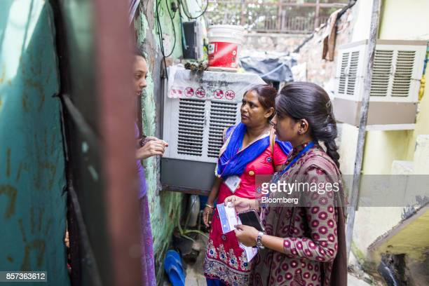 Amarjeet Kaur a payment collector for Tata Power Delhi Distribution Ltd known as an Abha center and another Abha right speak with a customer in the...