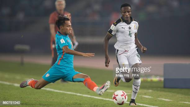 Amarjit Kiyam of India and Edmund ArkoMensah of Ghana battle for the ball during the FIFA U17 World Cup India 2017 group A match between Ghana and...
