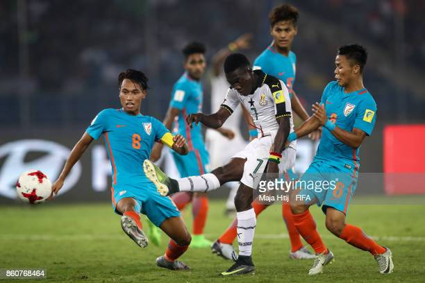 Amarjit Kiyam of India Ibrahim Sulley of Ghana and Suresh Wangjam of India battle for the ball during the FIFA U17 World Cup India 2017 group A match...