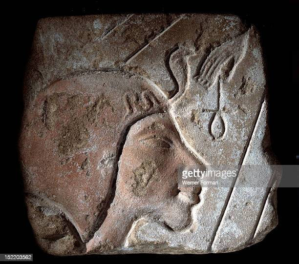Amarna relief depicting a member of the royal family receiving the beneficent rays of Aten The rays hold the ankh symbol of life Egypt Ancient...