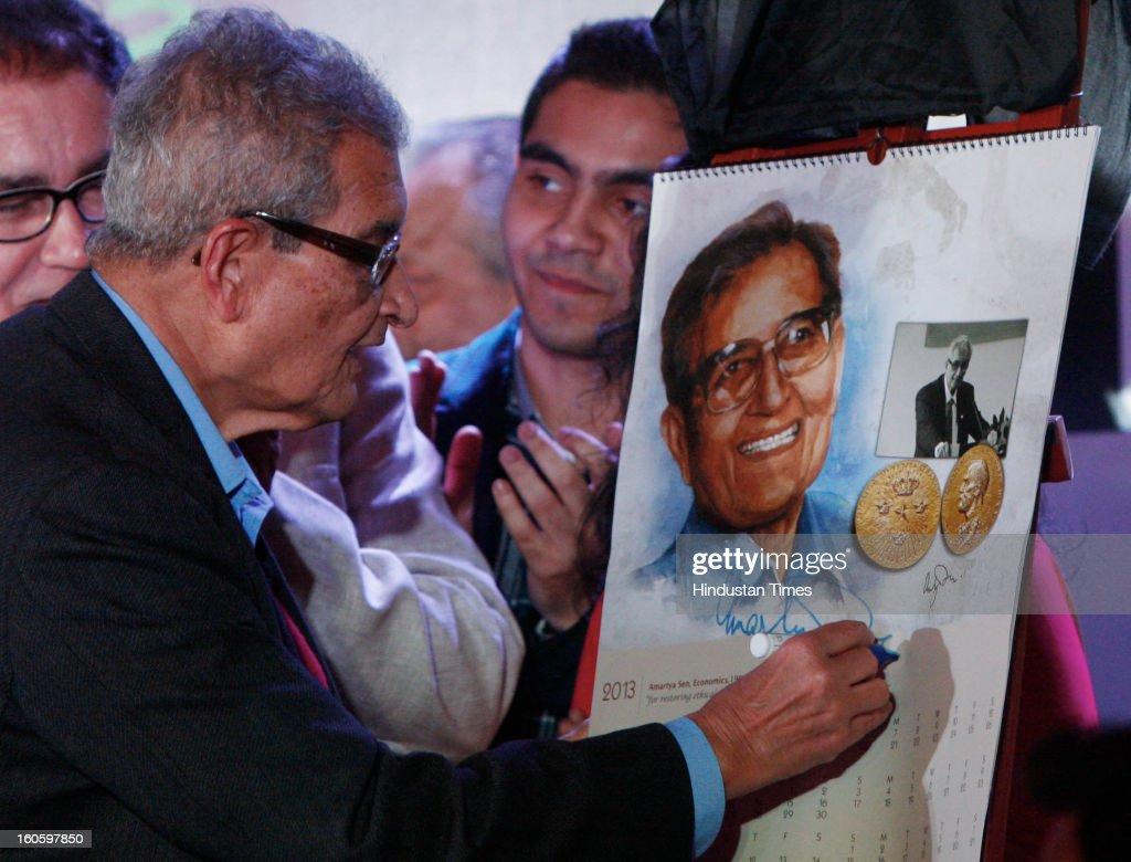 Amartya Sen is India's sixth Nobel Laureate Signing on his own photographs cum calendar at Kolkata Literary Meet 2013 on February 3, 2013 in Kolkata, India.
