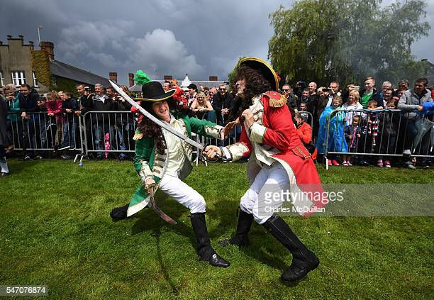Amateur actors playing the roles of King William and King James perform as thousands of spectators and marchers watch the annual Sham Fight in Scarva...