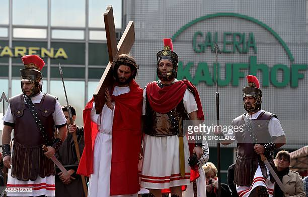 Amateur actors reenact the crucifixion of Jesus Christ during a Good Friday in Wuppertal western Germany on April 3 2015 Thousands of visitors across...