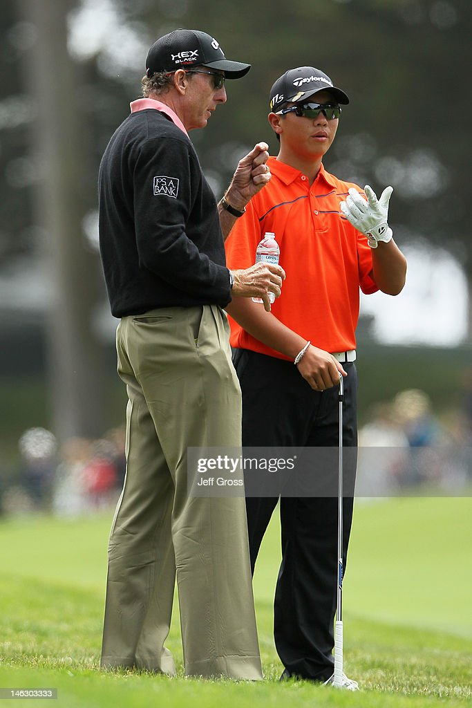 Amateur Andy Zhang of China chats with his coach David Leadbetter during a practice round prior to the start of the 112th U.S. Open at The Olympic Club on June 13, 2012 in San Francisco, California.