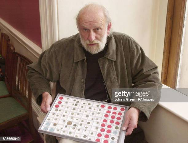 Amateur archaeologist Ken Wallace displays part of the largest hoard of Iron Age gold and silver coins ever found in Britain at the British Museum in...