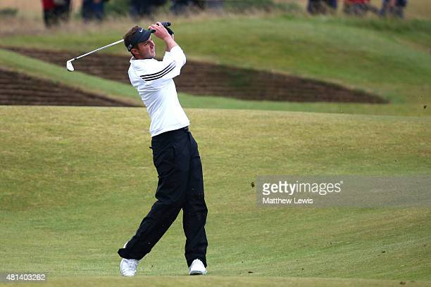 Amateur Ashley Chesters of England plays his third shot on the 14th hole during the final round of the 144th Open Championship at The Old Course on...
