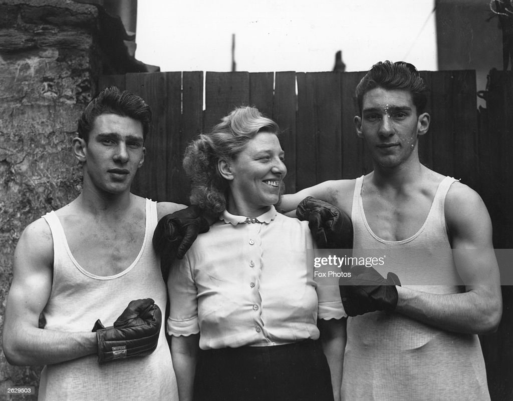 Amateur boxers Reggie (left) and Ronnie Kray with their mother Violet Kray. The Krays went on to become notorious London gangsters.