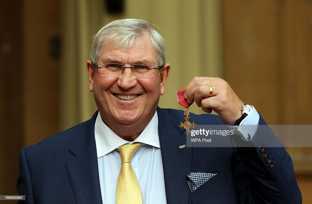 Amateur Boxing Association Chairman Keith Walters holds his medal after being made an Officer of the Order of the British Empire (OBE) by the Prince of Wales during an Investiture ceremony on October 23, 2013 at Buckingham Palace, London, England.