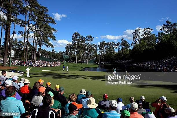 Amateur Bryson DeChambeau of the United States chases hit putt on the 16th green during the second round of the 2016 Masters Tournament at Augusta...