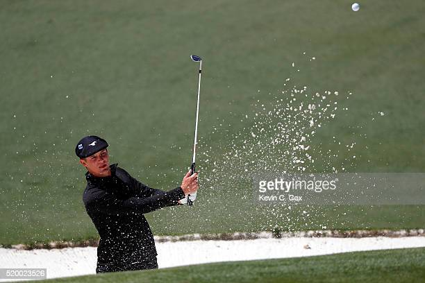 Amateur Bryson DeChambeau of the United States plays a shot from a bunker on the second hole during the third round of the 2016 Masters Tournament at...