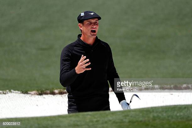 Amateur Bryson DeChambeau of the United States reacts to his third shot on the second hole during the third round of the 2016 Masters Tournament at...