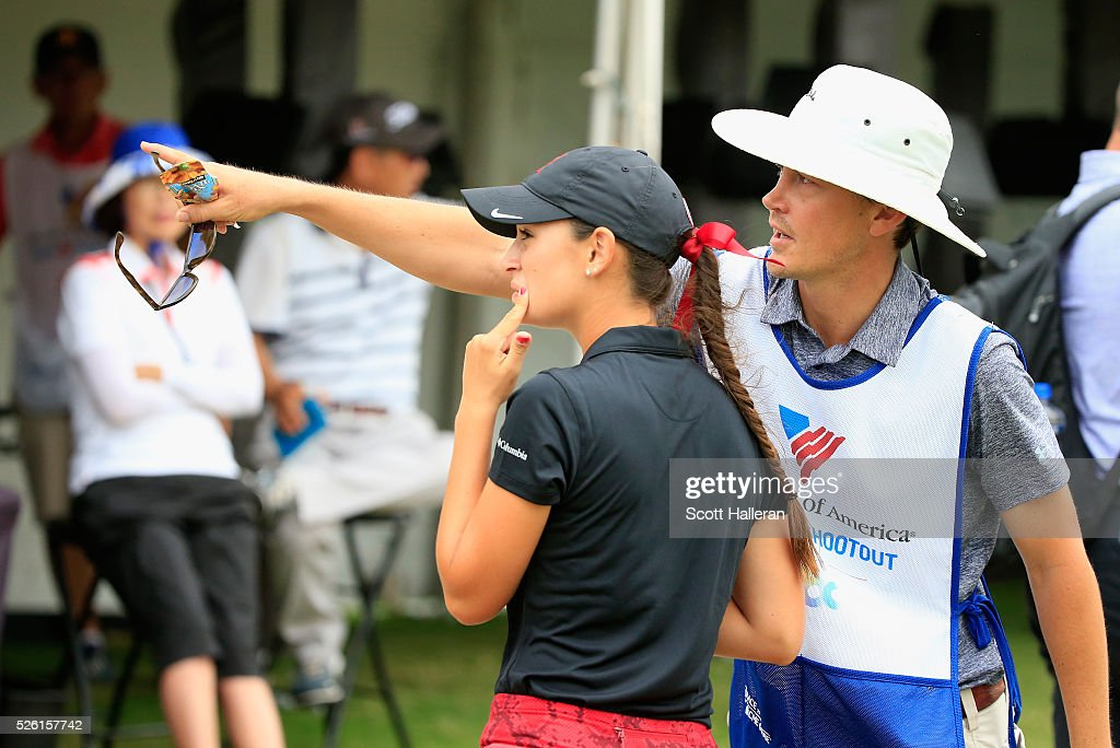 Amateur Cheyenne Knight chats with her caddie after play was suspended by dangerous weather during the second round of the Volunteers of America Texas Shootout at Las Colinas Country Club on April 29, 2016 in Irving, Texas.