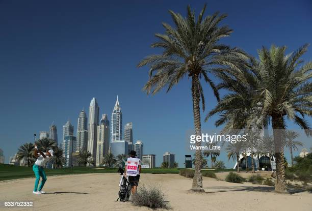 Amateur Curtis Luck of Australia plays his second shot into the eighth during the completion of the weather delayed second round of the Omega Dubai...