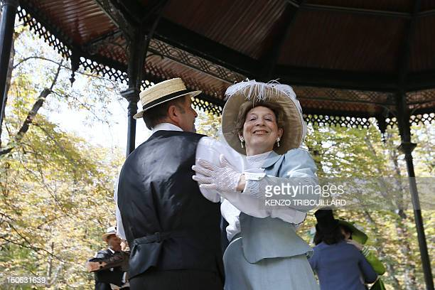 Amateur dancers dressed in 19th century period costumes take part in a 19th Century Ball at the bandstand of the Luxembourg Gardens on August 23 in...