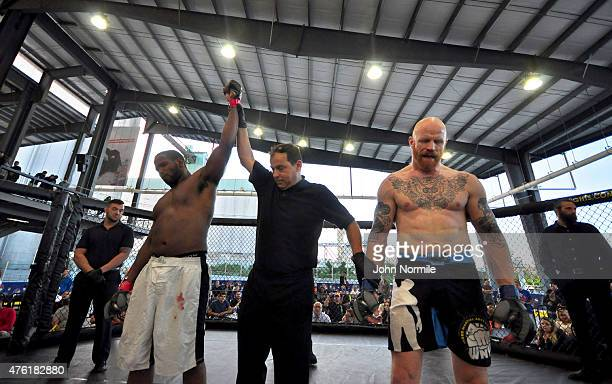 Amateur fighter Darren Foote raises his hand in victory over Douglas Miller at The TNT Fight Series June 6 2015 in Buffalo New York New York is the...