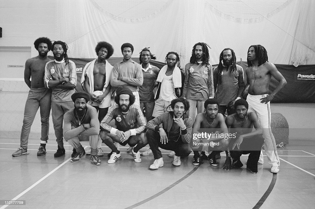 Amateur football teams led by Jamaican singer-songwriter <a gi-track='captionPersonalityLinkClicked' href=/galleries/search?phrase=Bob+Marley+-+Musician&family=editorial&specificpeople=240470 ng-click='$event.stopPropagation()'>Bob Marley</a> (1945 - 1981) and fellow reggae artist <a gi-track='captionPersonalityLinkClicked' href=/galleries/search?phrase=Eddy+Grant&family=editorial&specificpeople=2007574 ng-click='$event.stopPropagation()'>Eddy Grant</a> at a match, Hammersmith Leisure Centre, London, 16th July 1980, L-R (back) Rudy Grant, Alvin 'Seeco' Patterson, Alpine Grant, unknown member of <a gi-track='captionPersonalityLinkClicked' href=/galleries/search?phrase=Eddy+Grant&family=editorial&specificpeople=2007574 ng-click='$event.stopPropagation()'>Eddy Grant</a>'s team, Trevor Bow, Naptali, Neville Garrick, Gillie, <a gi-track='captionPersonalityLinkClicked' href=/galleries/search?phrase=Eddy+Grant&family=editorial&specificpeople=2007574 ng-click='$event.stopPropagation()'>Eddy Grant</a> and (front) Derek Donaldson, Alan 'Skill' Cole, <a gi-track='captionPersonalityLinkClicked' href=/galleries/search?phrase=Bob+Marley+-+Musician&family=editorial&specificpeople=240470 ng-click='$event.stopPropagation()'>Bob Marley</a> and two unknown member's of Grant's team.