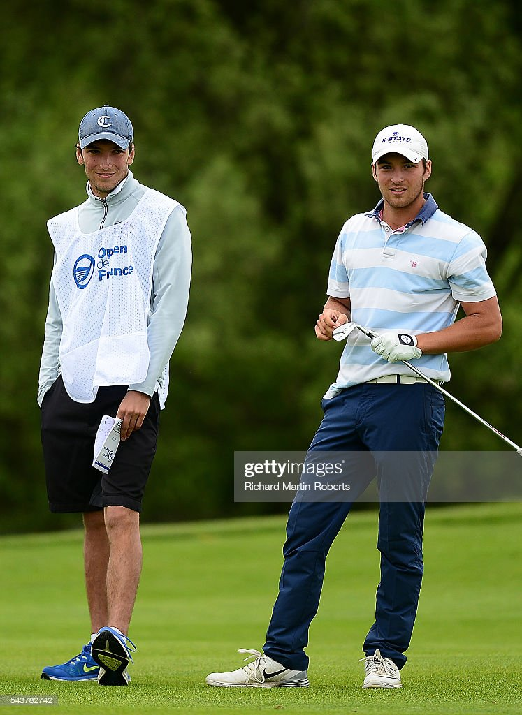 Amateur Jeremy Gandon of France looks on with his caddie/brother during the first round of the 100th Open de France at Le Golf National on June 30, 2016 in Paris, France.