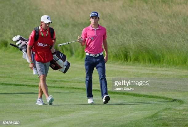 Amateur Joaquin Niemann of Chile and caddie Claudio Correa walk to tenth green during the first round of the 2017 US Open at Erin Hills on June 15...