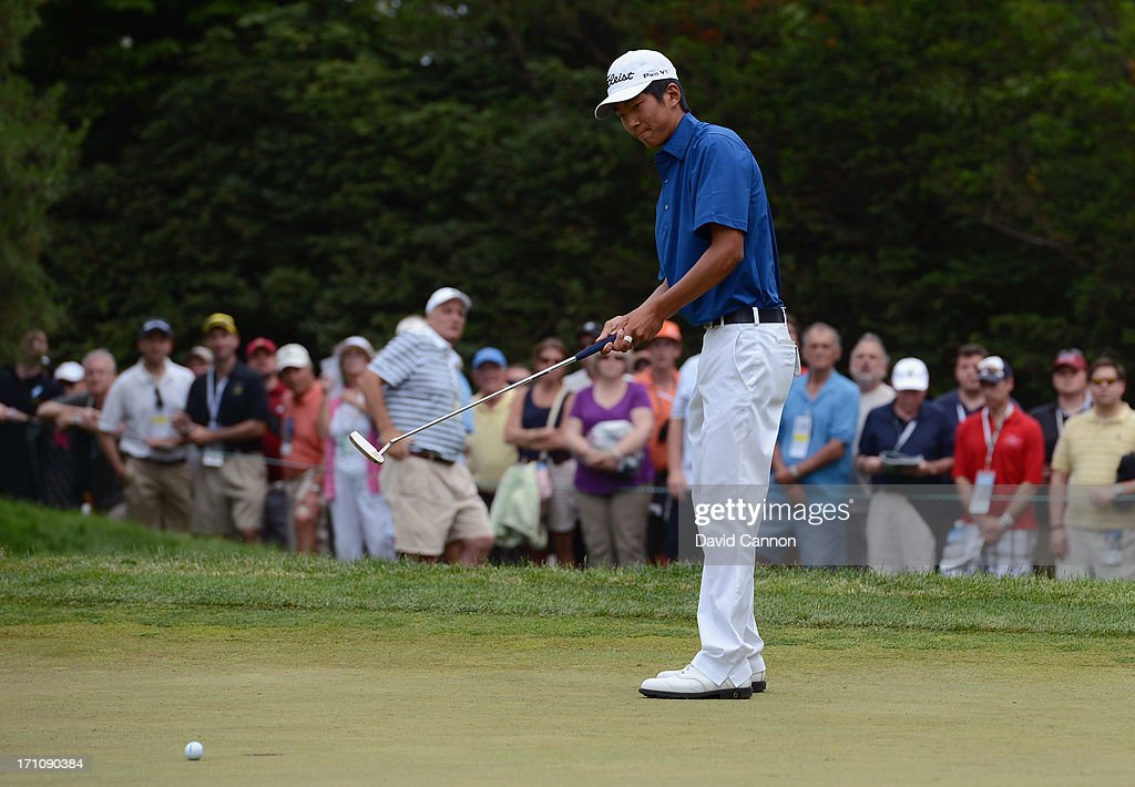 Amateur Michael Kim of the United States reacts to his putt during the final round of the 113th U.S. Open at Merion Golf Club on June 16, 2013 in Ardmore, Pennsylvania.