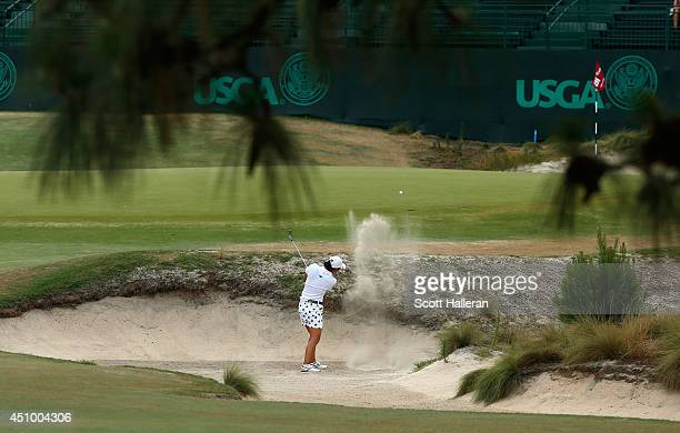 Amateur Minjee Lee of Australia plays a bunker shot on the 16th hole during the third round of the 69th US Women's Open at Pinehurst Resort Country...