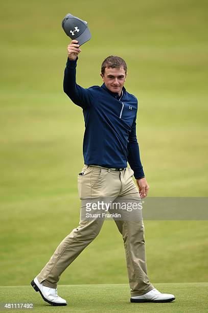 Amateur Paul Dunne of Ireland acknowledges the crowd on the 18th green during the second round of the 144th Open Championship at The Old Course on...