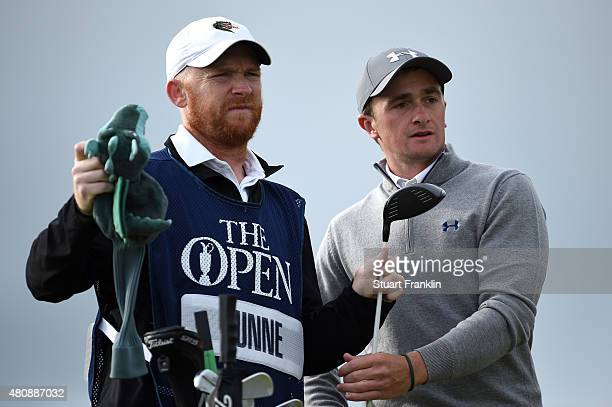 Amateur Paul Dunne of Ireland and caddie Alan Murrey look on from the 6th tee during the first round of the 144th Open Championship at The Old Course...