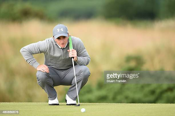 Amateur Paul Dunne of Ireland lines up putts on the 5th green during the first round of the 144th Open Championship at The Old Course on July 16 2015...