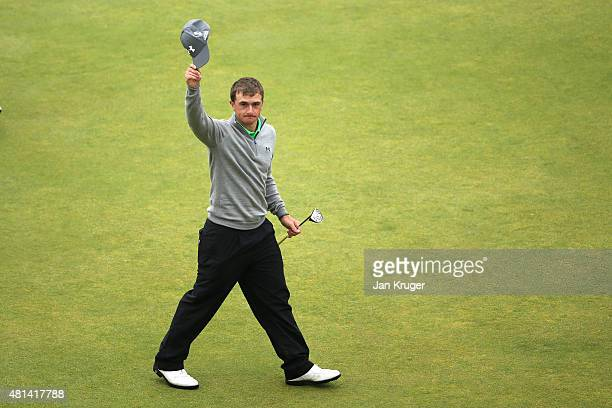 Amateur Paul Dunne of Ireland waves to the crowd on 18th green during the final round of the 144th Open Championship at The Old Course on July 20...