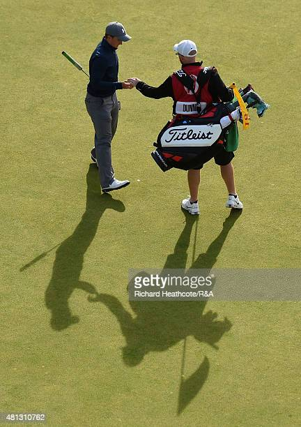 Amateur Paul Dunne of Ireland with his caddy Alan Murrey on the 18th green during the third round of the 144th Open Championship at The Old Course on...