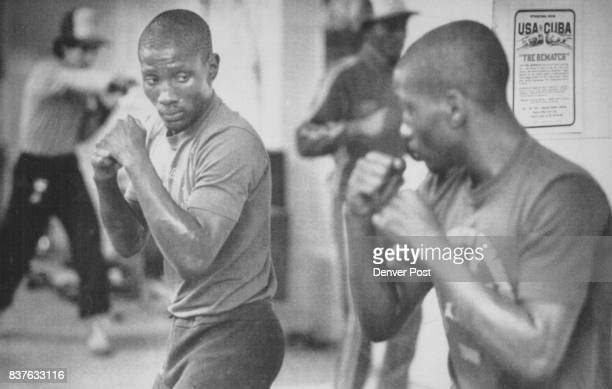 POST US amateur Pernell Whitaker of Norfolk Va shadow boxes in a mirror at the US training camp the day before meeting the Cuban boxing team in Reno...