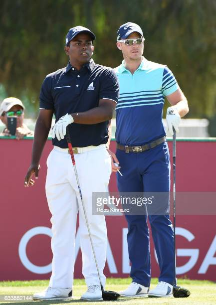 Amateur Rayhan Thomas of India of India looks on with Danny Willett of England during the final round of the Omega Dubai Desert Classic at Emirates...