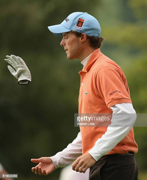 Amateur Reinier Saxton of The Netherlands tosses his glove in the air during the Second Round of The Barclays Scottish Open at Loch Lomond Golf Club...