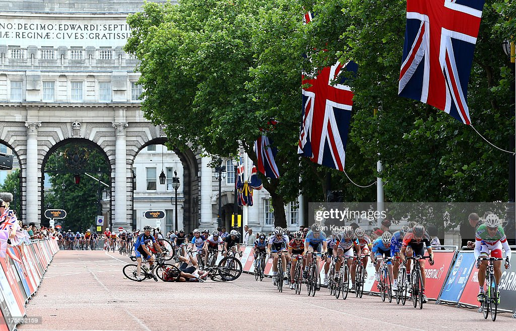 Amateur riders crash on the home straight during the Prudential RideLondon-Surrey 100 race on August 4, 2013 in London, England.