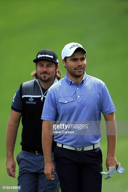 Amateur Romain Langasque of France and Victor Dubuisson of France walk during the Par 3 Contest prior to the start of the 2016 Masters Tournament at...