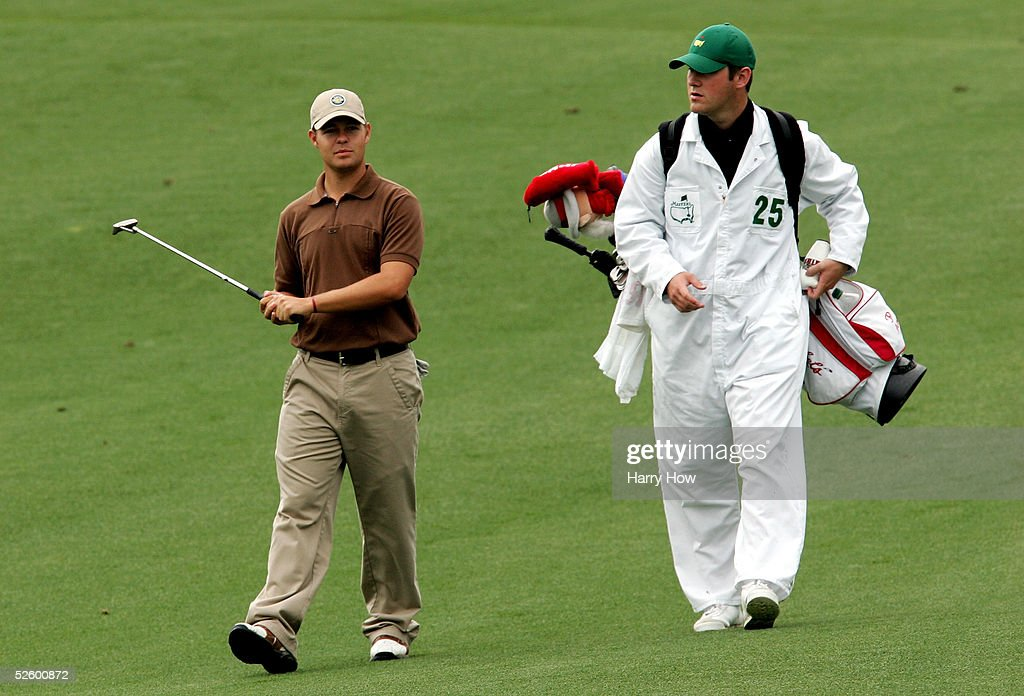Amateur Ryan Moore walks down the second hole with his caddie during the first round of The Masters at the Augusta National Golf Club on April 7, 2005 in Augusta, Georgia.