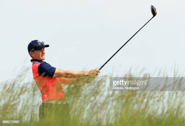 Amateur Scott Gregory of Engand plays his shot from the fifth tee during the first round of the 2017 US Open at Erin Hills on June 15 2017 in...