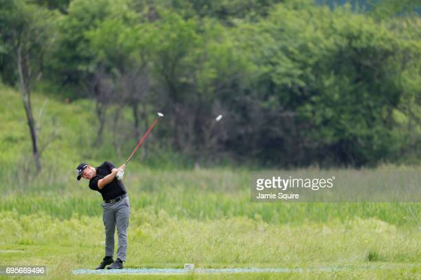 Amateur Scott Gregory of Engand plays his shot from the second tee during a practice round prior to the 2017 US Open at Erin Hills on June 13 2017 in...
