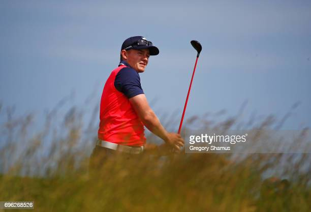 Amateur Scott Gregory of Engand plays his shot from the sixth tee during the first round of the 2017 US Open at Erin Hills on June 15 2017 in...