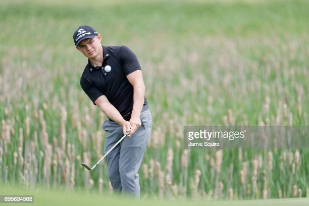Amateur Scott Gregory of England plays his shot on the first hole during a practice round prior to the 2017 US Open at Erin Hills on June 13 2017 in...