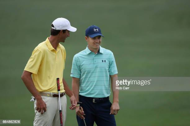 Amateur Stewart Hagestad of teh United States talks with Jordan Spieth of the United States on the second hole during a practice round prior to the...
