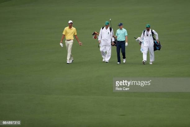 Amateur Stewart Hagestad of the United States and Jordan Spieth of the United States walk on the second hole during a practice round prior to the...