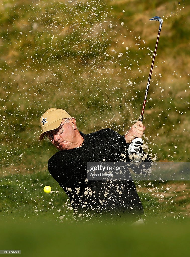 Amateur Toby Wilt plays a bunker shot on the first hole during the final round of the AT&T Pebble Beach National Pro-Am at Pebble Beach Golf Links on February 10, 2013 in Pebble Beach, California.