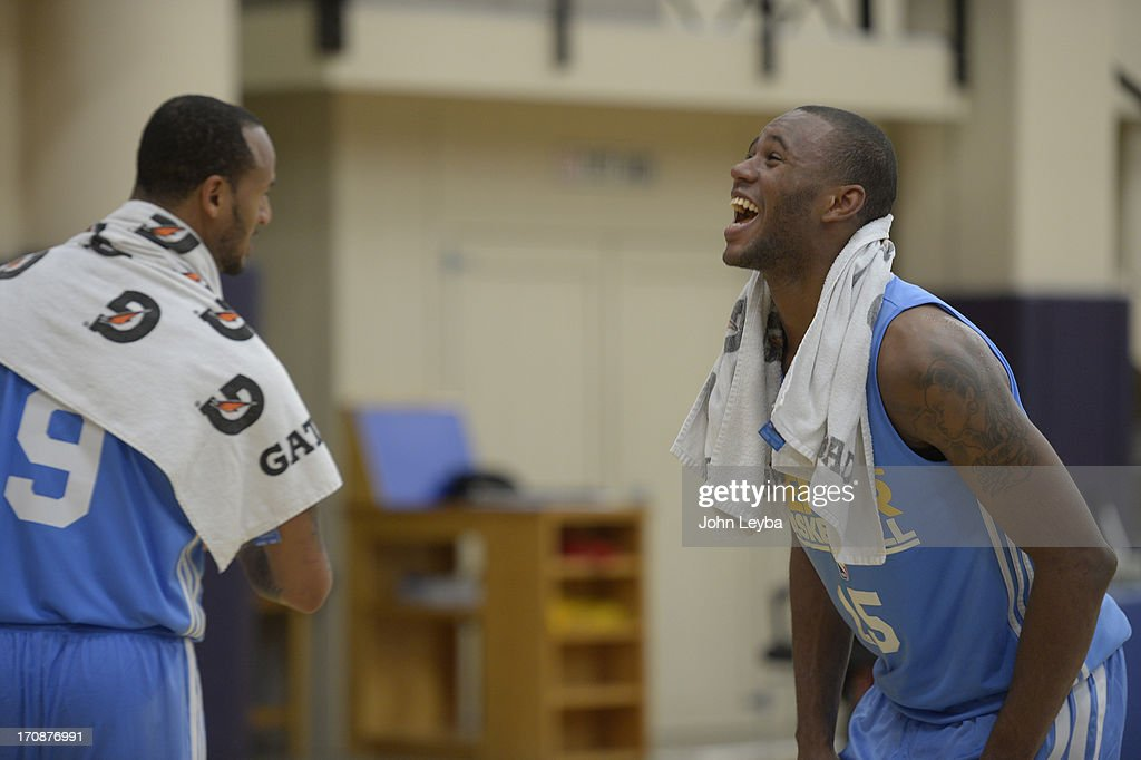 Amath M'Baye, Oklahoma (R) laughs with Travise Releford, Kansas during the Denver Nuggets invite to a pre draft workout June 19, 2013 at Pepsi Center.