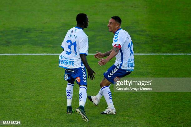 Amath Ndiaye Diedhiou of Tenerife SAD celebrates scoring their opening goal with teammate Jesus Manuel Santana alias Suso NT during the La Liga...