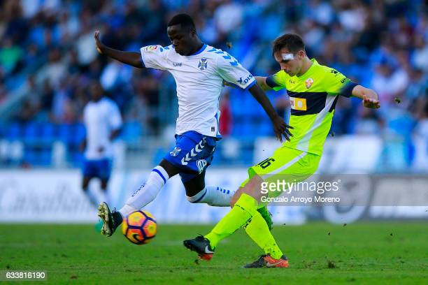 Amath Ndiaye Diedhiou of Tenerife SAD competes for the ball with Fabian Ruiz of Elche FC during the La Liga 2 match between CD Tenerife and Elche at...