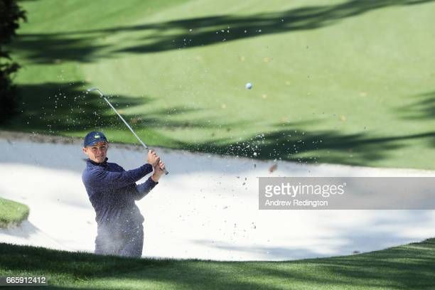 Amatuer Scott Gregory of England plays a shot from a bunker on the tenth hole during the second round of the 2017 Masters Tournament at Augusta...