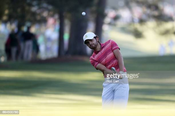 Amatuer Toto Gana of Chile chips to the second green during a practice round prior to the start of the 2017 Masters Tournament at Augusta National...