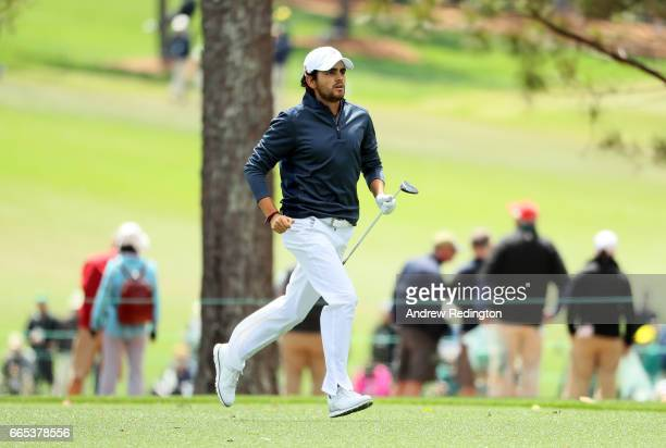 Amatuer Toto Gana of Chile runs to watch his shot on the first hole during the first round of the 2017 Masters Tournament at Augusta National Golf...