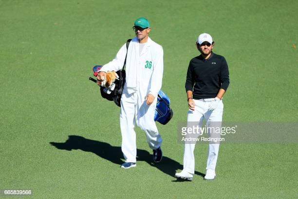 Amatuer Toto Gana of Chile walks with caddie Victor Slesarew on the second hole during the second round of the 2017 Masters Tournament at Augusta...
